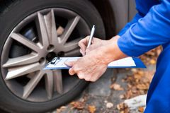 Worker maintaining car records Royalty Free Stock Photo