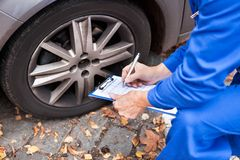 Worker maintaining car records Stock Image