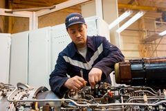 Worker maintaining helicopter engine. Tyumen. Tyumen, Russia - June 5, 2019: Aircraft repair helicopter UTair Engineering plant. Worker maintaining engine of Mi stock images