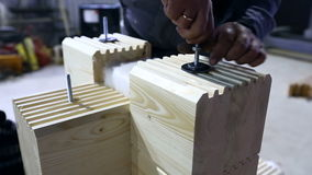 Worker makes blank for construction of glulam stock video