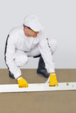 Worker makes a luting cement huwk Royalty Free Stock Photo