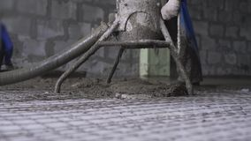Worker making cement screed on the floor view stock footage