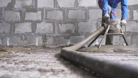 Worker making cement screed on the floor view stock video