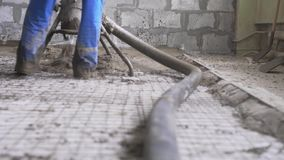 Worker making cement screed on the floor view stock video footage