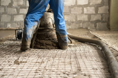 Worker making cement screed on the floor view Royalty Free Stock Image