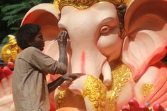 Worker making Ganesh idol in hyderabad, India Stock Image