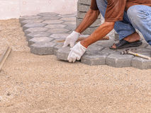 Worker making pavement Stock Image