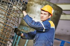 Worker making reinforcement for pipe Stock Images