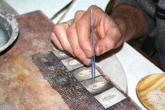 Worker making silver jewellery. Worker making telkari (turkish silver jewellery Royalty Free Stock Image
