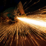 Worker making sparks while welding steel royalty free stock photography