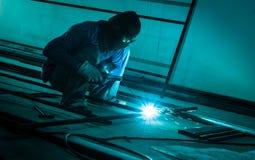Worker making sparks  welding steel Stock Photos