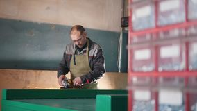 The worker male grinding the steel mechanism on industry. Close up stock video