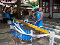 Man working building a hammock Stock Photo