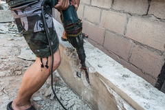 Worker man drilling cement concrete floor with machine Stock Images