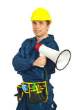 Worker man holding loudspeaker Royalty Free Stock Image