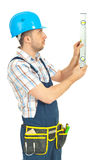 Worker man measuring with bubble level Stock Image