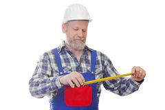 The worker man. Portrait of a worker useing a tape measure Royalty Free Stock Photography