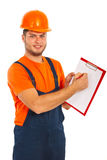 Worker man showing clipboard. Note isolated on white background Stock Photos