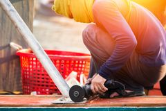 The worker man use grinding. The worker man use grinding on the ground Stock Photos