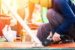 The worker man use grinding. The worker man use grinding on the ground Royalty Free Stock Image