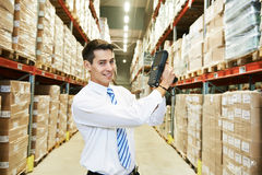 Worker man with warehouse barcode scanner Royalty Free Stock Image
