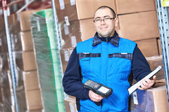 Worker man with warehouse barcode scanner Stock Image