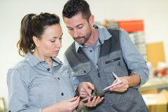 Worker man and woman discussing something. Worker men and women discussing something woman royalty free stock photo