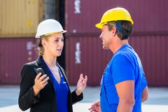 Worker and Manager on container terminal of port. Discussing Royalty Free Stock Photos