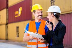 Workers in logistics company discussing documents Royalty Free Stock Images