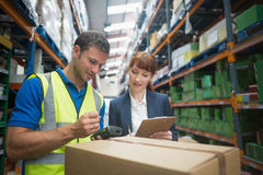 Worker and manager scanning package in warehouse Royalty Free Stock Photo