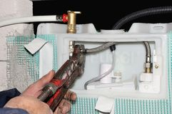 Worker manifold mounting thermal water system Royalty Free Stock Photography