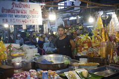Worker at a market in Chiang Mai, Thailand. Woman selling mango sticky rice, a Thai specialty item at a food market in the Northern city of Chiang Mai, Thailand Stock Images