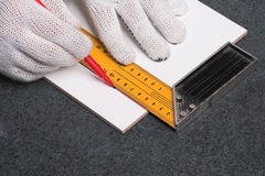 Worker marking a ceramic tile Royalty Free Stock Image