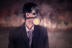 Worker with mask and forest fire Stock Image
