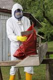 Worker with mask packing Asbestos Disposal. A Worker with mask packing Asbestos Disposal stock photography