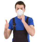 Worker with a mask and a thumbs up sign Stock Images