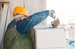 Worker mason at bricklaying work Stock Image