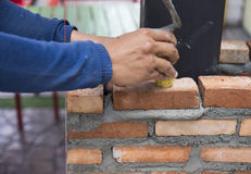 The worker is masoning the brick Royalty Free Stock Images