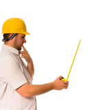 Worker with measure. Man holding measure on white Stock Photography