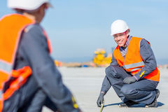 Worker measure construction. Builder measure construction runway airport new concrete Stock Photo