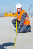 Worker measure construction. Builder measure construction runway airport new concrete Royalty Free Stock Photography