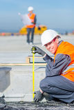Worker measure construction. Builder measure construction runway airport new concrete Stock Photography