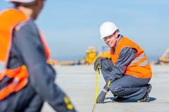 Worker measure construction. Builder measure construction runway airport new concrete Stock Photo