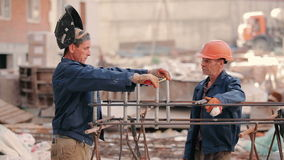 The worker measure the distance between the pipes stock footage