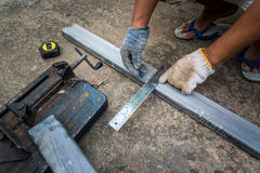 Worker measurement the steel with square triangle scale Royalty Free Stock Photography