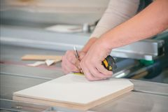Worker measures the exact size of the cutting parts. Worker measures the exact size of the parts royalty free stock photos