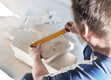Worker measures the ruler silicate brick Royalty Free Stock Photography