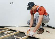 Worker measures the wooden board. Stock Images