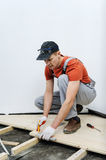 Worker measures the wooden board. Stock Photo