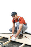 Worker measures the wooden board. Royalty Free Stock Image